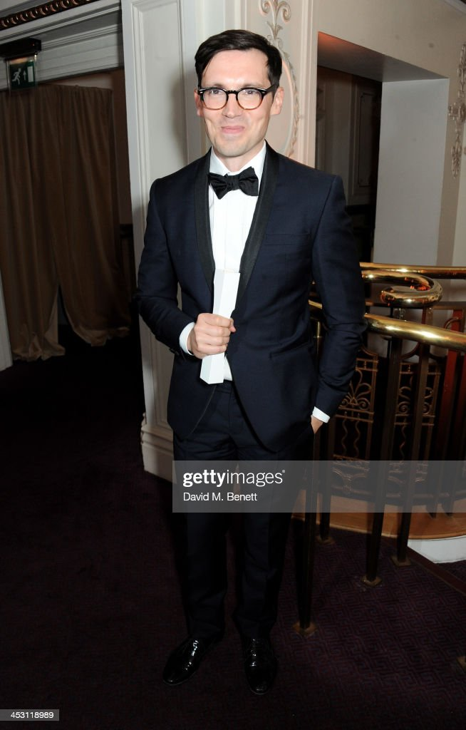 Erdem Moralioglu, winner of the Red Carpet award, poses at the British Fashion Awards 2013 at London Coliseum on December 2, 2013 in London, England.