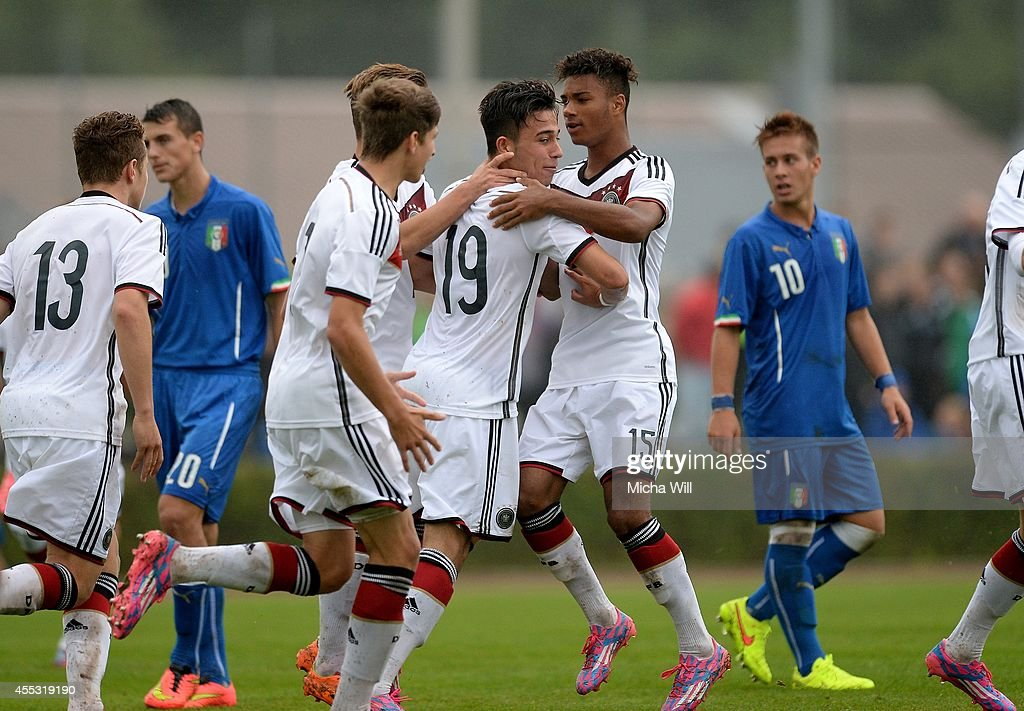 Erdinc Karakas (C) of Germany celebrates with team-mates after scoring his team's first goal during the KOMM MIT tournament match between U17 Germany and U17 Italy on September 12, 2014 in Kelheim, Germany.