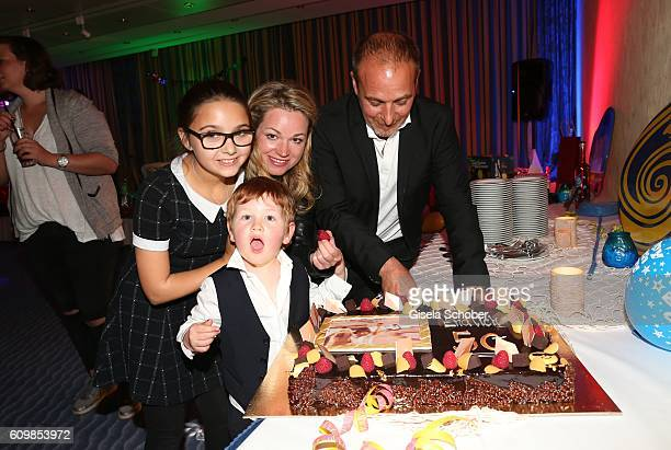 Erdogan Atalay and his partner Katja Ohneck daughter Pauletta Amira Pollmann and son Maris Atalay during the surprise party for Erdogan Atalay's 50th...