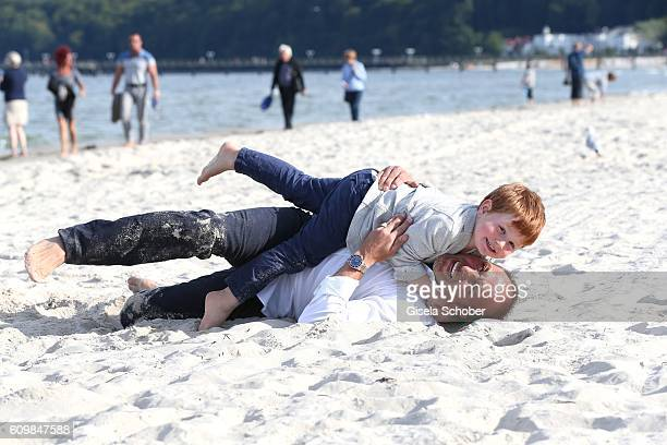 Erdogan Atalay celebrates his 50th birthday with his son Maris Atalay on September 22 2016 in Binz Germany