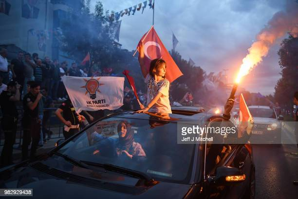 Erdogan's supporters celebrate outside the AK party headquarters on June 24 2018 in Istanbul Turkey Turkey's President Recep Tayyip Erdogan is...