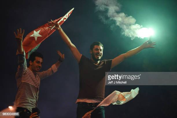 Erdogan's supporters celebrate outside the AK party headquarters on June 24 2018 in Istanbul Turkey Turkey's President Recep Tayyip Erdogan has...