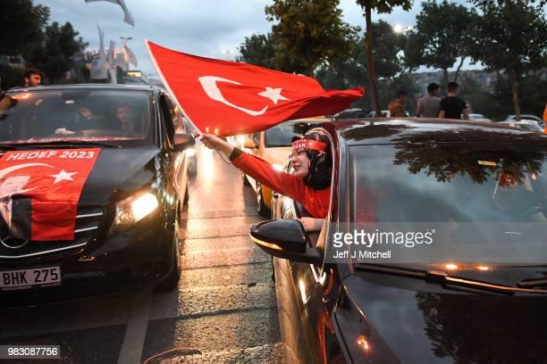 Erdogan's supporters celebrate outside the AK party headquarters on June 24 2018 in Istanbul Turkey Turkey's President Recep Tayyip Erdogan has...