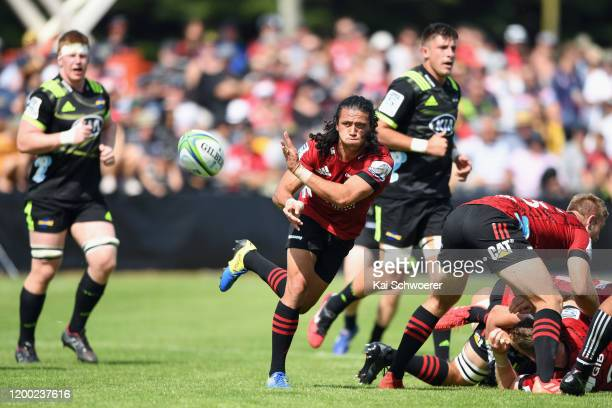 Ereatara Enari of the Crusaders passes the ball during the Super Rugby preseason match between the Crusaders and the Hurricanes at the Showgrounds on...
