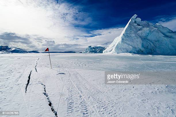 Cracks appear in melting sea ice during the summer in Antarctica.