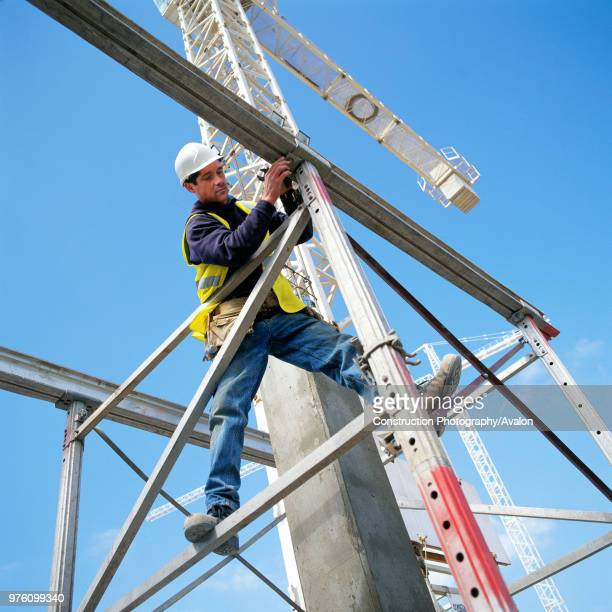 Erecting a scaffolding tower.