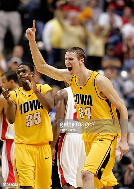 Erek Hansen of the Iowa Hawkeyes celebrates alongside teammate Mike Henderson as the Hawkeyes won the Big 10 Tournament Championship game 6760...