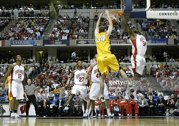 Erek Hansen of the Iowa Hawkeyes dunks the ball as Terence Dials of the Ohio State Buckeyes flies by during the Big 10 Tournament Championship game...