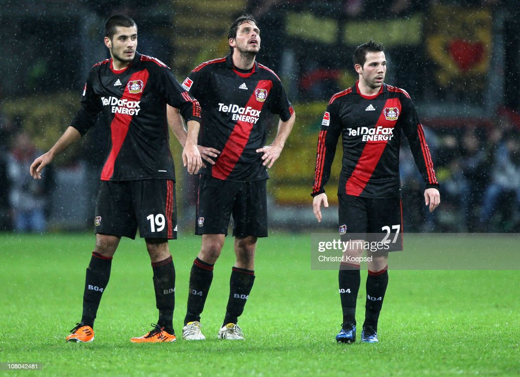 Eren Derdiyok, Manuel Friedrich and Gonzalo Castro of Leverkusen look dejected after losing 1-3 the Bundesliga match between Bayer Leverkusen and Borussia Dortmund at BayArena on January 14, 2011 in Leverkusen, Germany.