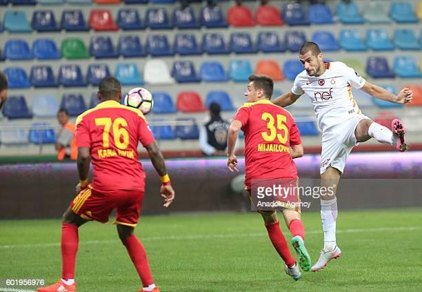 Eren Derdiyok of Galatasaray is in action during the Turkish Spor Toto Super Lig football match between Kayserispor and Galatasaray at Kadir Has...
