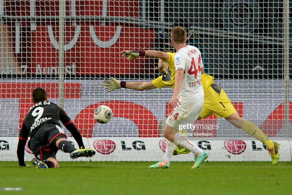 Eren Derdiyok (L) of Leverkusen scores his team's second goal during the Bundesliga match between Bayer Leverkusen and VfB Stuttgart at BayArena on February 1, 2014 in Leverkusen, Germany.