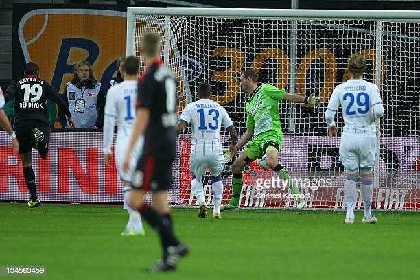 Eren Derdiyok of Leverkusen scores the first goal against Tom Starke of Hoffenheim during the Bundesliga match between Bayer 04 Leverkusen and 1899...