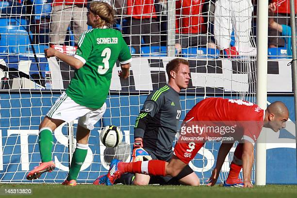 Eren Derdiyok of Switzerland scores the opening goal against Marc-Andre Ter Stegen keeper of Germany and his team mate Marcel Schmelzer during the...