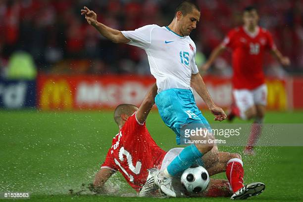 Eren Derdiyok of Switzerland tackles Emre Asik of Turkey during the UEFA EURO 2008 Group A match between Switzerland and Turkey at St JakobPark on...
