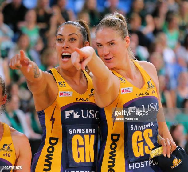 Erena Mikaere of the Sunshine Coast Lightning and Caitlin Bassett of the Sunshine Coast Lightning look to the crowd after their win during the Super...