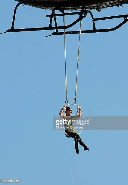 Erendira Wallenda performs prior to the running of the Bank of America 500 on Sunday Oct 11 at Charlotte Motor Speedway in Concord NC