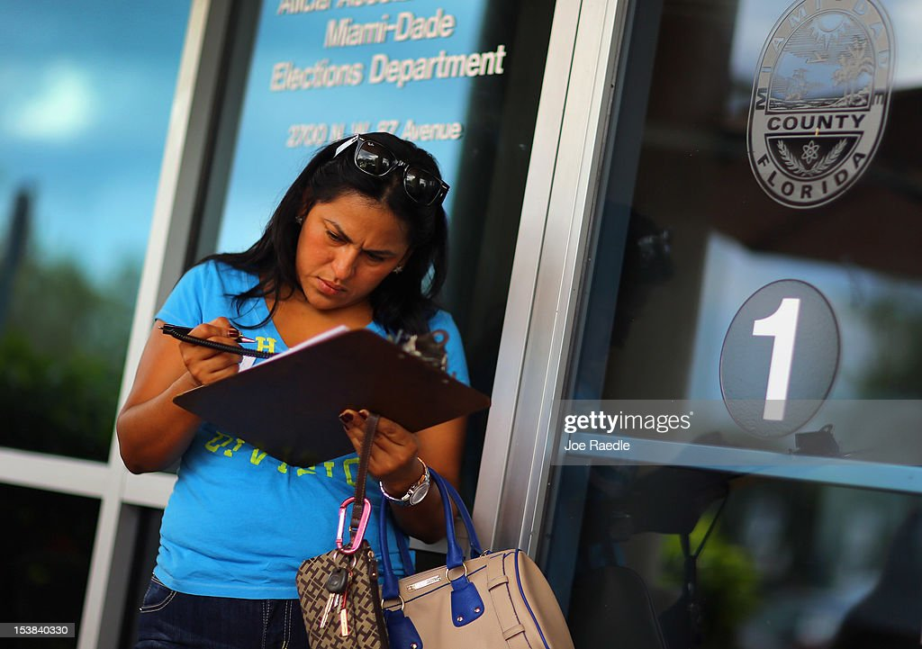 Ereyda Monge fills out her voter registration form at the Miami-Dade Elections Department on the final day for her to vote in the upcoming elections on October 9, 2012 in Miami, Florida. The Republicans and Democrats are battling it out for the election, less than a month away.