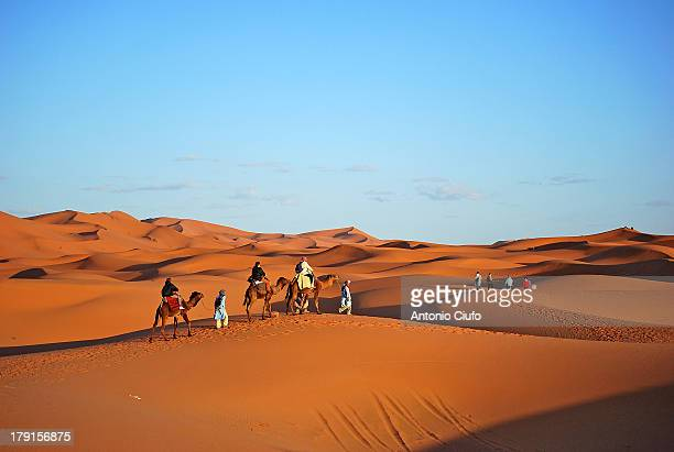 Erg Chebbi, Morocco. Legend says that the Erg Chebbi dunes are Allah's punishment that buried a wealthy local family with a sandstorm because he had...