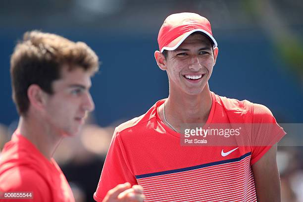 Ergi Kirkin of Turkey and Alexei Popyrin of Australia during their first round junior doubles match against Toru Horie of Japan and Nicola Kuhn of...