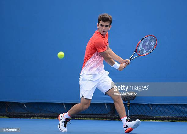 Ergi Kirkin of Turkey returns the ball to Elliot Benchetrit of France during Junior Boys' Singles on day six of the 2016 Australian Open on January...