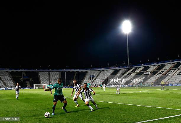 Ergys Kace and Giannis Skondras of PAOK defend Jefferson Farfan of Schalke during the UEFA Champions League second leg play-off match between PAOK...