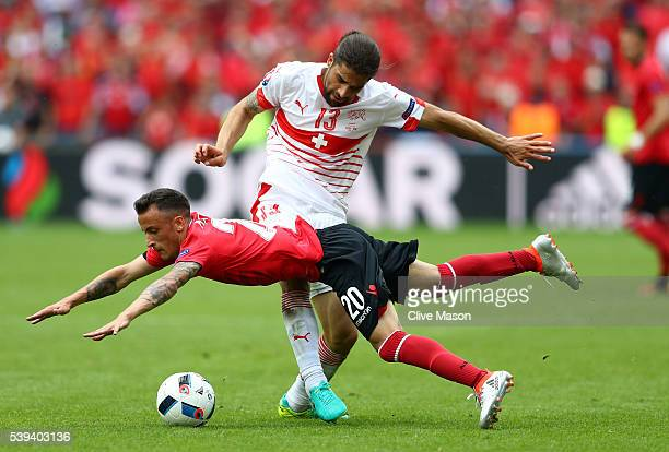 Ergys Kace of Albania and Ricardo Rodriguez of Switzerland compete for the ball during the UEFA EURO 2016 Group A match between Albania and...
