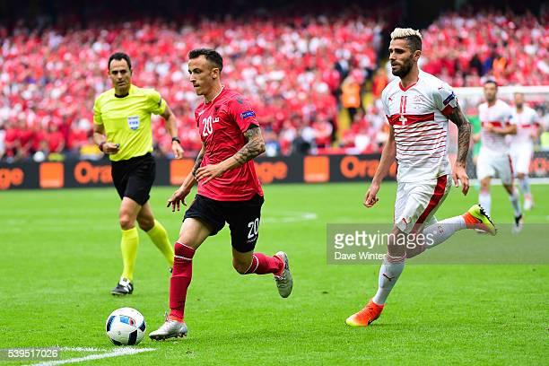 Ergys Kace of Albania and Valon Behrami of Switzerland during Group-A preliminary round between Albania and Switzerland at Stade Bollaert-Delelis on...
