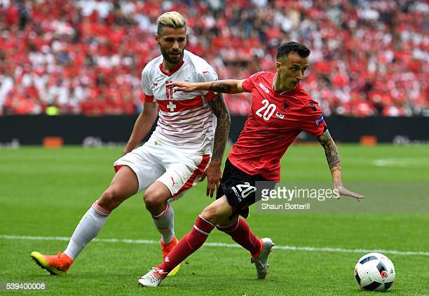 Ergys Kace of Albania controls the ball under pressure of Valon Behrami of Switzerland during the UEFA EURO 2016 Group A match between Albania and...