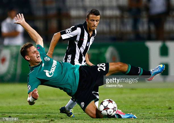 Ergys Kace of PAOK fouls Adam Szalai of Schalke during the UEFA Champions League second leg play-off match between PAOK Saloniki and FC Schalke 04 at...