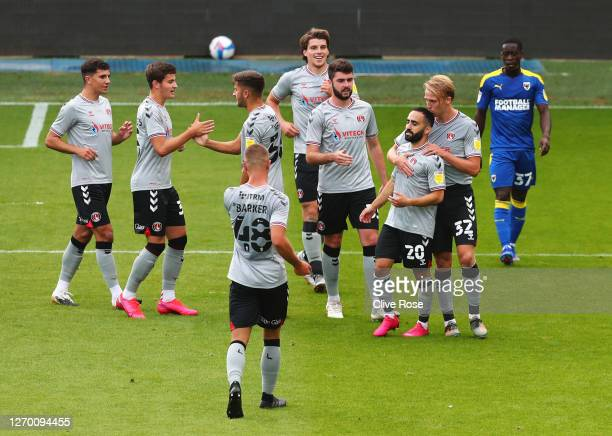 Erhun Oztumer of Charlton Athletic celebrates with team mates as he scores their first goal during the EFL Trophy match AFC Wimbledon and Charlton...