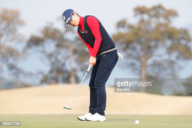 Eri Fukuyama putts on the 18th hole in her playoff with Kurumi Dohi during the final round of the Rashink Nijinia/RKB Ladies at the Queens Hill Golf...