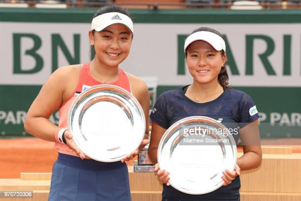 Eri Hozumi and Makoto Ninomiya of Japan celebrate with their runners up trophies following the ladies doubles final against Barbora Krejcikova and...