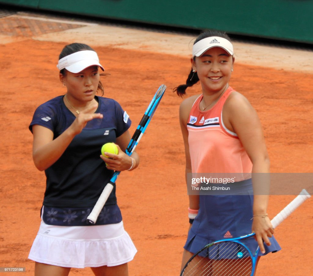 Eri Hozumi (R) and Makoto Ninomiya (L) of Japan talk in the ladies doubles final against Barbora Krejcikova and Katerina Siniakova of the Czech Republic during day fifteen of the 2018 French Open at Roland Garros on June 10, 2018 in Paris, France.