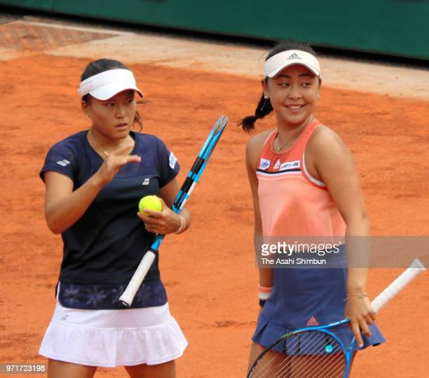 Eri Hozumi and Makoto Ninomiya of Japan talk in the ladies doubles final against Barbora Krejcikova and Katerina Siniakova of the Czech Republic...