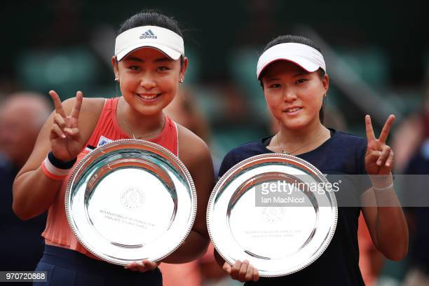 Eri Hozumi and Makoto Ninomiya of Japanpose with their runners up trophies after their Women's Doubles Final match against Katerina Siniakova and...