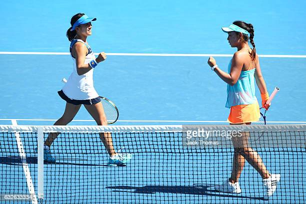 Eri Hozumi and Miyu Kato of Japan compete in their quarterfinal match against Bethanie MattekSands of the United States and Lucie Safarova of the...