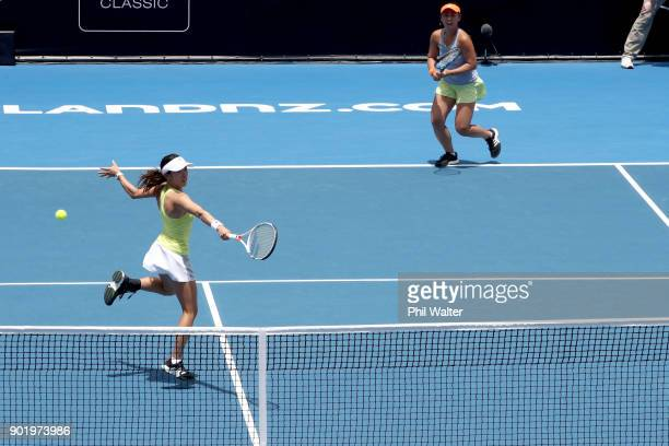 Eri Hozumi and Miyu Kato of Japan in action against Sara Errani of Italy and Bibiane Schoofs of Netherlands in the Womens Doubles Final on day seven...
