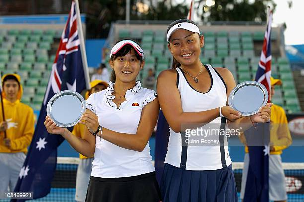Eri Hozumi and Miyu Kato of Japan poses with the runnersup trophy after the junior girls doubles final match against Demi Schuurs of the Netherlands...