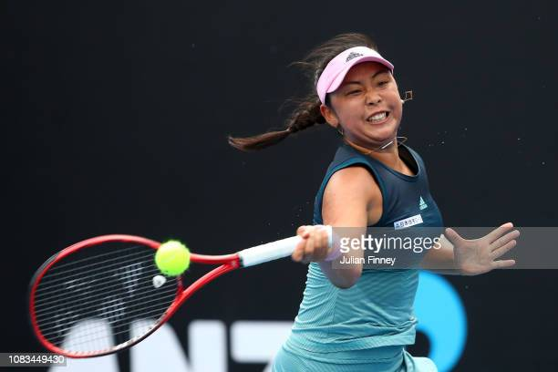 Eri Hozumi of Japan plays a forehand in her first round doubles match with Alicja Rosolska of Poland against Andrea Petkovic of Germany and Monica...