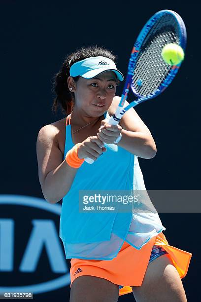 Eri Hozumi of Japan plays a shot in her first round doubles match against Ellen Perez and Olivia Tjandramulia of Australia on day three of the 2017...