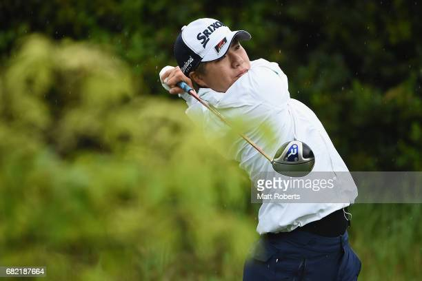 Eri Okayama of Japan hits her tee shot on the 11th hole during the first round of the HokennoMadoguchi Ladies at the Fukuoka Country Club Wajiro...