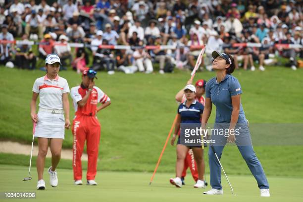 Eri Okayama of Japan looks dejected after her putt on the 18th green during the final round of the Munsingwear Ladies Tokai Classic at Shin Minami...
