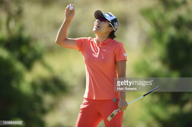 Eri Okayama of Japan reacts after her putt on the 15th hole during the final round of the Stanley Ladies at Tomei Country Club on October 7, 2018 in...