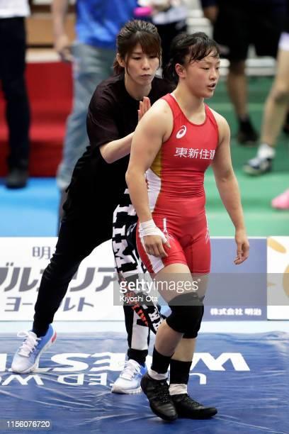 Eri Tosaka competes against Kika Kagata while Saori Yoshida is seen in the Women's 50kg semifinal match on day three of the All Japan Wrestling...