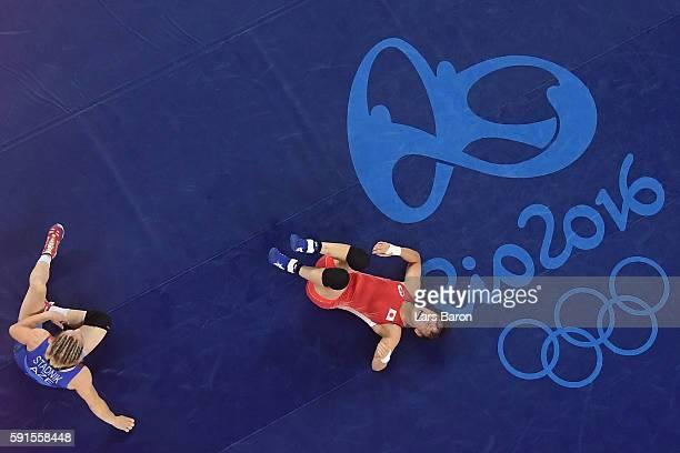 Eri Tosaka of Japan celebrates winning gold against Mariya Stadnik of Azerbaijan in the Women's Freestyle 48kg event on Day 12 of the Rio 2016...
