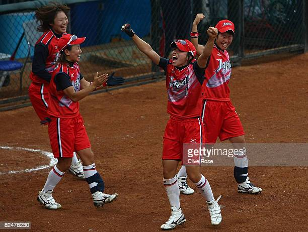 Eri Yamada and Rei Nishiyama of Japan celebrate a 2run hit by teammate Megu Hirose in the bottom of the fourth inning against Australia in the bronze...
