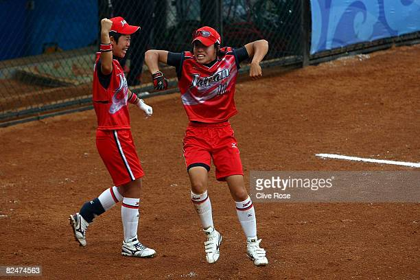 Eri Yamada and Rei Nishiyama of Japan celebrate a 2run home run hit by teammate Megu Hirose in the bottom of the fourth inning against Australia in...