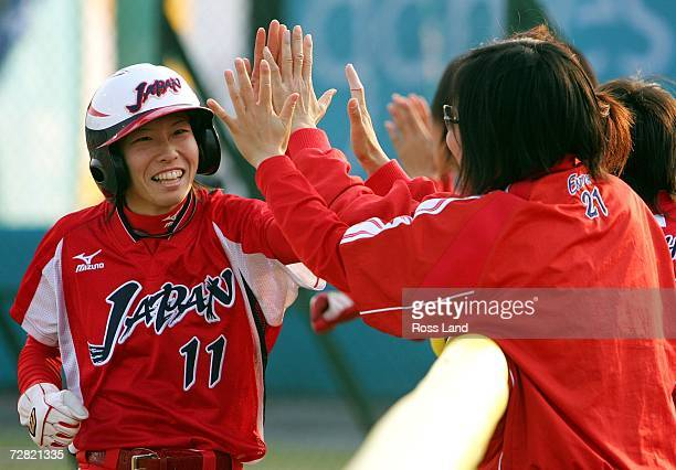 Eri Yamada celebrates scoring with team mates during the Gold Medal Game against Chinese Taipei at the 15th Asian Games Doha 2006 at the AlRayyan...