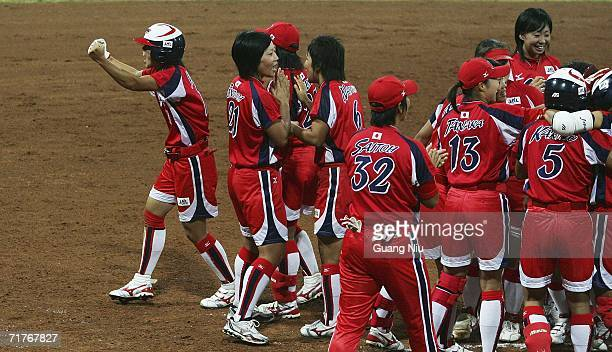 Eri Yamada of Japan and her players celebrate after they won the match 21 against Australia during ISF XI Women's Fast Pitch Softball World...