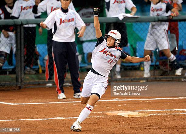 Eri Yamada of Japan celebrates hitting a solo homer in the 4th inning during the women's grand final gold medal softball game between Japan and...